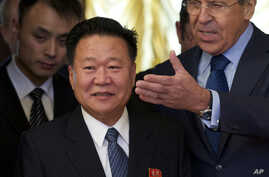 Russian Foreign Minister Sergey Lavrov, right, welcomes North Korea's special envoy Choe Ryong Hae during their meeting in Moscow, Russia, Nov. 20, 2014.