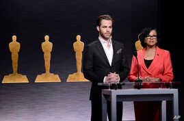Chris Pine, left, and Academy President Cheryl Boone Isaacs announce the Academy Awards nominations at the 87th Academy Awards nomination ceremony on Jan. 15, 2015 in Beverly Hills, Calif.