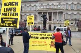 Demonstrators protest the death of Freddie Gray, who died a week after he was rushed to the hospital with spinal injuries following an encounter with several Baltimore police officers, outside Baltimore City Hall, April 20, 2015.