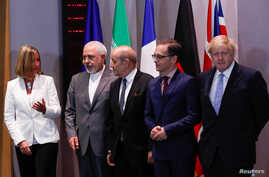 Britain's Foreign Secretary Boris Johnson, German Foreign Minister Heiko Maas, French Foreign Minister Jean-Yves Le Drian and EU High Representative for Foreign Affairs Federica Mogherini take part in meeting with Iran's Foreign Minister Mohammad Jav
