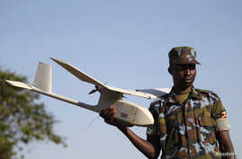 FILE - A soldier from the Uganda People's Defense Forces (UPDF) gives a demonstration on a Raven unmanned aircraft at the Kasenyi Special Forces Group barracks 40km (25 miles) south west of capital Kampala.