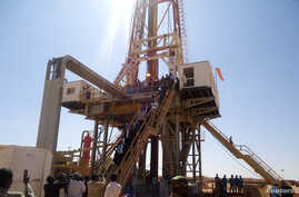 FILE - Engineers and visitors explore an exploratory well near Dharoor town, from the port of Bosasso on the Gulf of Aden in Puntland, Somalia.