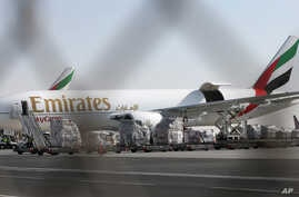 An Emirates Airline cargo plane loads goods at the Al Maktoum International Airport in Dubai, United Arab Emirates, Nov. 9, 2015.