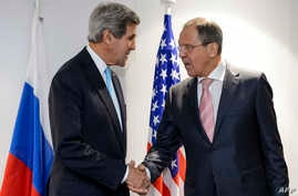 US Secretary of State John Kerry (L) and Russian Foreign Minister Sergei Lavrov shake hands during a bilateral on the sideline of an Organization for Security and Cooperation in Europe (OSCE) meeting in Basel, Switzerland, Dec. 4, 2014.
