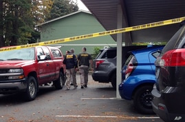Mall Shooting-Washington: Investigators are seen at the apartment complex that has been tied to Arcan Cetin, the suspected Cascade Mall shooter, in Oak Harbor, Wash., Sunday, Sept. 25, 2016.