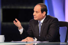 File: Presidential candidate Abdel Fattah el-Sissi talks during a TV interview broadcast on CBC and ONTV, in Cairo, May 6, 2014.