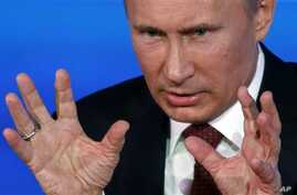 Russian President Vladimir Putin speaks during a news conference in Moscow, Russia, Thursday, Dec. 20, 2012. Russian President Vladimir Putin has rejected charges of authoritarianism and lashed out at the United States in his annual marathon news con