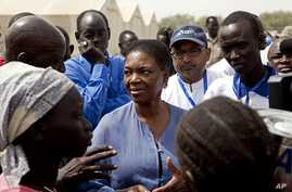 United Nations Under-Secretary-General for Humanitarian Affairs and Emergency Relief Coordinator for South Sudan, Valerie Amos, engages with local government officials and humanitarian aid workers in the village of Walgak, South Sudan on Thursday, Fe