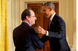 French President Francois Hollande shakes hands with President Barack Obama after their joint news conference in the East Room of the White House,  Feb. 11, 2014.