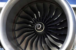 FILE - The blades of a huge Rolls Royce engine on an Airbus A350 XWB test flight aircraft, parked at Newark Liberty international airport in Newark, N.J.