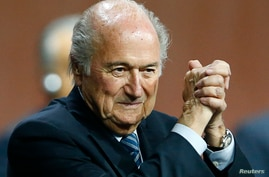 FIFA President Sepp Blatter gestures after he was re-elected at the 65th FIFA Congress in Zurich, Switzerland, May 29, 2015.