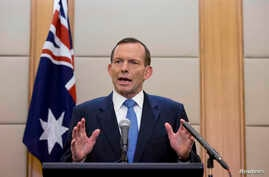 Australian Prime Minister Tony Abbott speaks during a press conference at a hotel in Beijing, China, April 12, 2014.