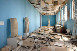 FILE - This file photo released March 27, 2016, by the Syrian official news agency shows destroyed statues at the damaged Palmyra Museum, in the city of Palmyra, Syria. Palmyra, the archaeological gem that Islamic State fighters retook Dec. 11, 2016,