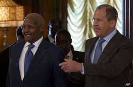 Russian Foreign Minister Sergey Lavrov, right, welcomes Ugandan counterpart Sam Kutesa, Moscow, May 12, 2014.