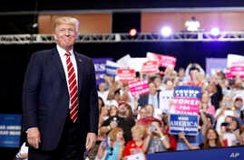 President Donald Trump stands before speaking at a rally at the Phoenix Convention Center, Aug. 22, 2017, in Phoenix.