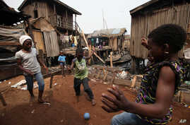 Children play in the Makoko slum, in Lagos, Nigeria where houses accessible only by canoe sit on stilts above polluted waters of the Lagos lagoon, January 21, 2011