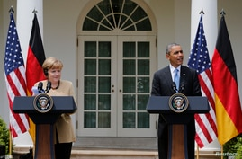 U.S. President Barack Obama and German Chancellor Angela Merkel address a joint news conference in the Rose Garden of the White House in Washington May 2, 2014.