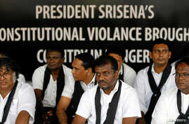 Members of a civil society activist group attend a silent protest to demand for democracy in the country, after Sri Lankan opposition leader Mahinda Rajapaksa was appointed prime minister when President Maithripala Sirisena dismissed Ranil Wickremesi
