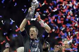 New England Patriots' Tom Brady raises the Vince Lombardi Trophy after defeating the Atlanta Falcons in overtime at Super Bowl 51, Feb. 5, 2017, in Houston. The Patriots defeated the Falcons 34-28.