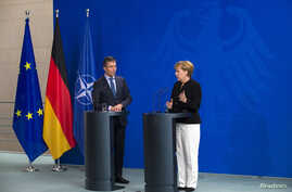 German Chancellor Angela Merkel (R) and NATO Secretary General Anders Fogh Rasmussen attend a news conference after talks at the Chancellery in Berlin July 2, 2014.