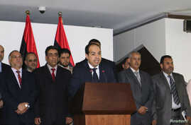 Libya's new Prime Minister Ahmed Maiteeq speaks at a news conference with members of the government in Tripoli, Libya, June 2, 2014.