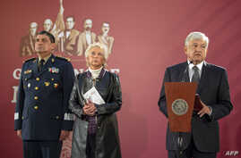 FILE - Mexico's President Andres Manuel Lopez Obrador, accompanied by Secretary General of Defense Luis Cresencio Sandoval (L) and Interior Minister Olga Sanchez Cordero, gives a press conference at the National Palace in Mexico City, Dec. 3, 2018.