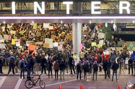 Hundreds of people opposed to President Donald Trump's executive orders barring entry to the U.S. of seven predominantly Muslim countries demonstrate at the Tom Bradley International Terminal at Los Angeles International Airport, Jan. 28, 2017.