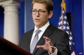 White House press secretary Jay Carney gestures while talking about problems with the Obamacare website during his daily news briefing at the White House in Washington, Oct. 23, 2013.