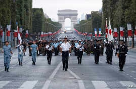 Japanese troops parade on the Champs Elysees avenue during a rehearsal for Bastille Day, early Wednesday, July 11, 2018, in Paris. Japanese and Singapore soldiers will take part in the annual Bastille Day next Saturday.