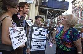 Linda Jacknow, 70, of Long Island, N.Y., right, an opponent of the proposed Islamic center and mosque  to be built near Ground Zero argues against Aviva Stampfer, 21, of Manhattan, N.Y., left, and Blake Luley, 23, of Brooklyn, N.Y., both in favor of