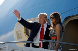 U.S. President Donald Trump and first lady Melania Trump board Air Force One during their departure back to Washington, at Hamburg International Airport, in Hamburg, Germany, July 8, 2017.