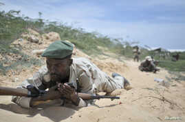 Soldiers from the Somali National Army (SNA) participate in a training exercise in Mogadishu March 28, 2013 in this picture provided by the AU/UN Information Support Team.