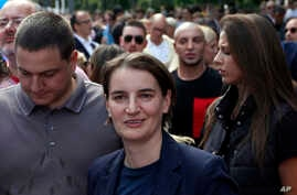 Serbian Prime Minister Ana Brnabic, center, attends a gay pride march in Belgrade, Serbia, Sept. 17, 2017.