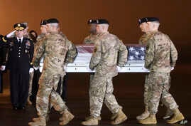 Army Chief of Staff Gen. Mark A. Milley, left, salutes as an Army carry team moves a transfer case containing the remains of Maj. Brent R. Taylor at Dover Air Force Base, Del., on Tuesday, Nov. 6, 2018.