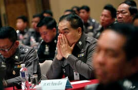 Policemen listen to Thai Police Chief, General Somyot Poompanmoung, during a meeting on anti-trafficking at police headquarters in Bangkok, Thailand, May 8, 2015.