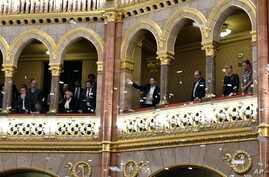 Opposition lawmakers throw flyers from the balcony at the start of the plenary session of the parliament in Budapest, Hungary, Dec. 12, 2018.