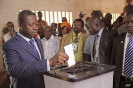 FILE - Togo President Faure Gnassingbe casts his ballot in Lome during legislative elections July 25, 2013.