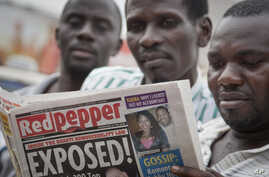"""A Ugandan reads a copy of the """"Red Pepper"""" tabloid newspaper in Kampala, Feb. 25, 2014."""