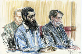 In this courtroom drawing, Abid Naseer, front left, sits next to his court-appointed legal adviser, James Neuman, as they listen to the guilty verdict against Naseer in federal court in Brooklyn, New York, March 4, 2015.