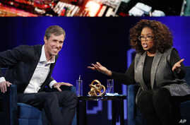 "Former Democratic Texas congressman Beto O'Rourke, left, appears with Oprah Winfrey for ""Oprah's SuperSoul Conversations from Times Square,"" Feb. 5, 2019, in New York."