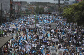 National University students, professors and employees march to the National Palace to take part in a national strike calling for the resignation of Guatemalan President Otto Perez Molina, in Guatemala City, Thursday, Aug. 27, 2015.