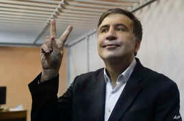 Former Georgian President Mikheil Saakashvili gestures in a court room in Kiev, Ukraine, Dec. 11, 2017.