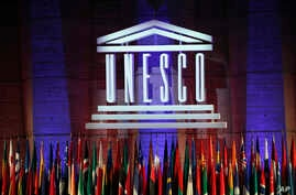 FILE - The logo of the United Nations Educational, Scientific and Cultural Organisation (UNESCO) is seen druing a conference at UNESCO headquarters in Paris, France, Nov. 4, 2017.