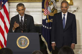 President Barack Obama, accompanied by Attorney General Eric Holder, speaks in the State Dining Room of the White House, Sept. 25, 2014, to announce Holder is resigning.