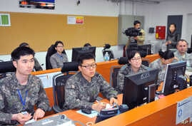 A commanding post for war games shows U.S. and South Korean soldiers working together in a U.S. military camp in Seoul, South Korea, March 15, 2013.