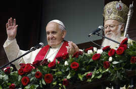 Pope Francis, left, and Ecumenical Patriarch Bartholomew I bless the faithful gathered in the courtyard of the Patriarchal Church of St. George in Istanbul, Nov. 30, 2014.