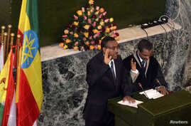 Ethiopia's new deputy Prime Minister Mekonnen Demeke (L) takes the oath of office during the swearing-in ceremony in Addis Ababa, September 21, 2012.