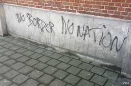 Graffiti on this Brussels refugee camp echoes the sentiments of many refugees and other migrants traveling from the Middle East and Africa to Europe. (Heather Murdock/VOA), 23 November, 2015.
