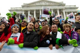 FILE - Rep. Luis Gutierrez (D-Illinois), third from left, along with other demonstrators protest outside of the U.S. Capitol in support of the Deferred Action for Childhood Arrivals (DACA) during a rally on Capitol Hill in Washington, Dec. 6, 2017.