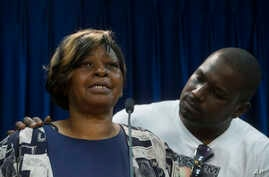 Audrey DuBose, mother of Samuel DuBose, is comforted by her son Aubrey as she speaks to the media after murder and manslaughter charges against University of Cincinnati police officer Ray Tensing were announced for the traffic stop shooting death of